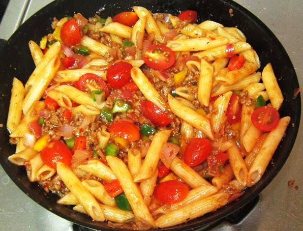 Mix in Penne and honey tomatoes for Baked Beef Penne Recipe